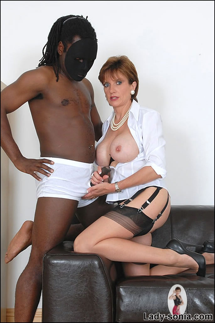 Sexy milf teases cock with her nylon feet and lets him cum on her stockings 6