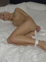 Bondage sex. Nataly tied in white nylons - - Unique Bondage - Pic 1
