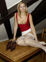 Bdsm sex. Blonde Jenni in stockings spreads. - Unique Bondage - Pic 14