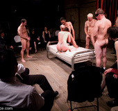 Nude in public. Bobbi Starr, bound, services a roomful of people.