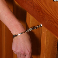 Paula handcuffed in the stairs - Unique Bondage - Pic 10