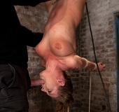 Girl next door is hung upside down, bound in a reverse strappado, Skull