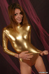 Petite teen beauty in gold latex outfit touching…