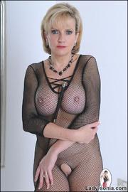 Fishnet catsuit mature dominatrix - Unique Bondage - Pic 1