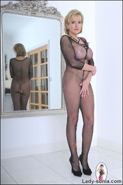 Fishnet catsuit mature dominatrix - Unique Bondage - Pic 2