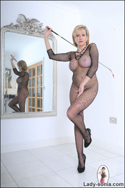 Fishnet catsuit mature dominatrix - Unique Bondage - Pic 4