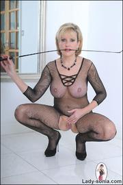Fishnet catsuit mature dominatrix - Unique Bondage - Pic 9