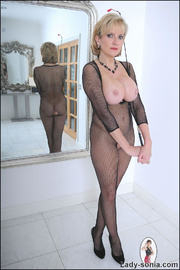 Fishnet catsuit mature dominatrix - Unique Bondage - Pic 15