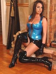 Busty brunette wearing a latex outfit - Unique Bondage - Pic 4