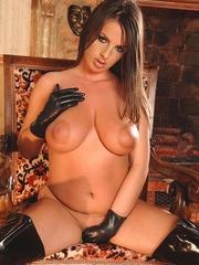 Busty brunette wearing a latex outfit - Unique Bondage - Pic 14