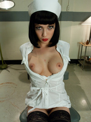 Sexy restrained nurse is enthusiastic about - Unique Bondage - Pic 1