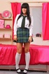 Gorgeous college girl in tartan miniskirt and…
