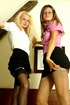 Two sexy babes in secretary outfits