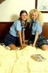 Karen & Olivia in college uniforms with socks