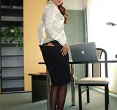 Secretary Claudia in black nylons strips