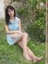 Stunning babe in short dress exposing her lovlely feet outdoors.