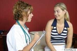Tan nurse gives a sex exam to a white gi - XXX Dessert - Picture 2