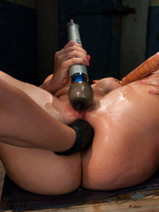 She spreads her legs and takes a huge dildo - Unique Bondage - Pic 1