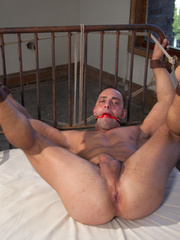 Blindfolded and bondaged gay hunk gets his - Unique Bondage - Pic 13