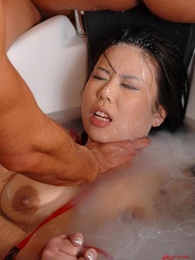 Blonde pees on the Asian face with some - Unique Bondage - Pic 3