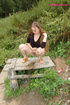 Female pee. Dirty teen slut sits for a piss on a picnic table.