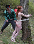 Spanking porn. Tearful redhead tied to a tree in the forest and brutally